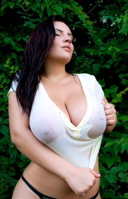 Magnificent lady with tempting shapes showing true melons