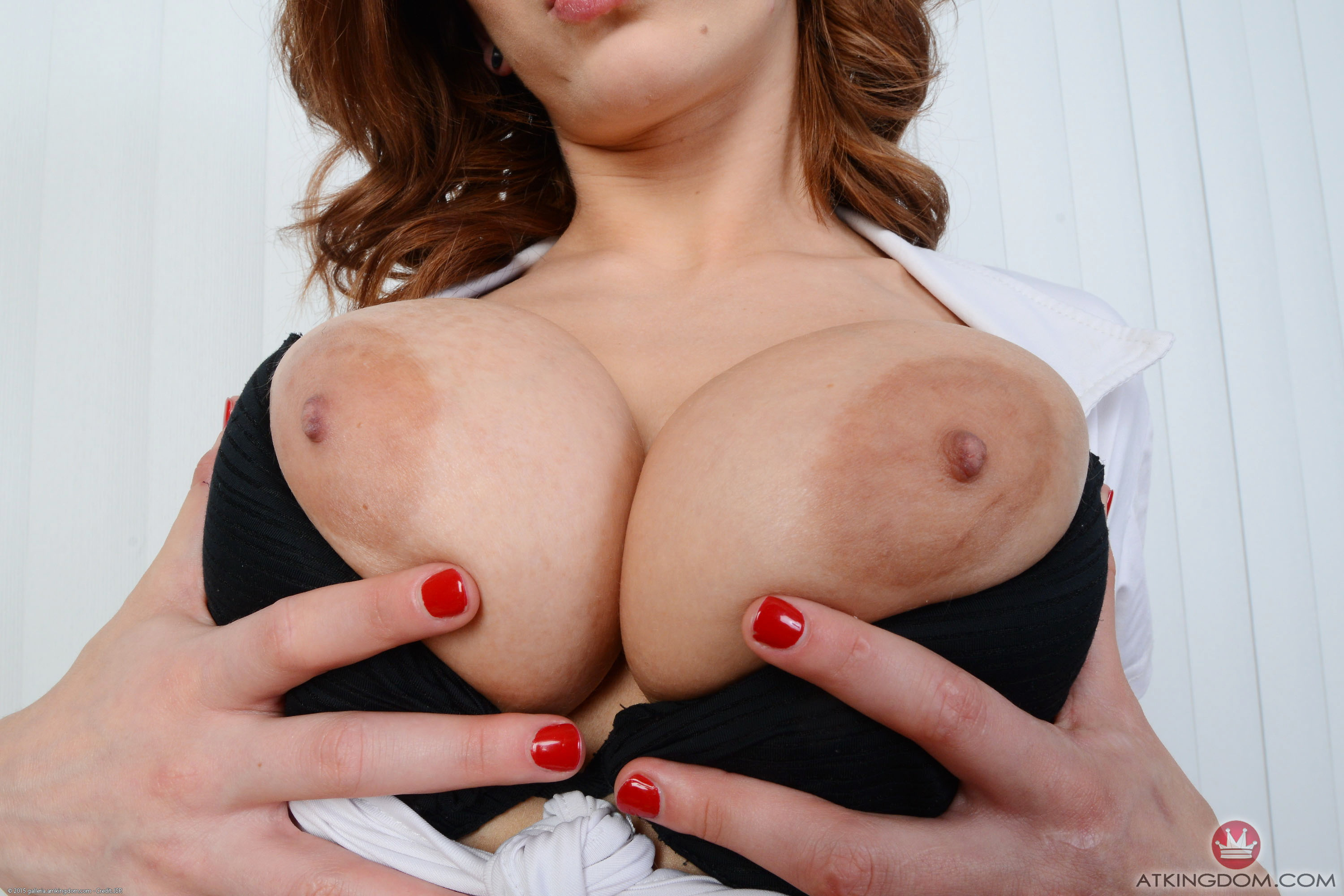 Svelte girl with graceful face open up impressive breasts
