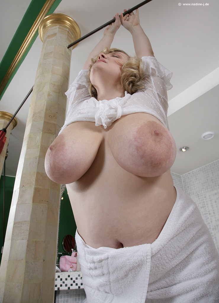 Amazing angel with gorgeous face shows magnificent udders