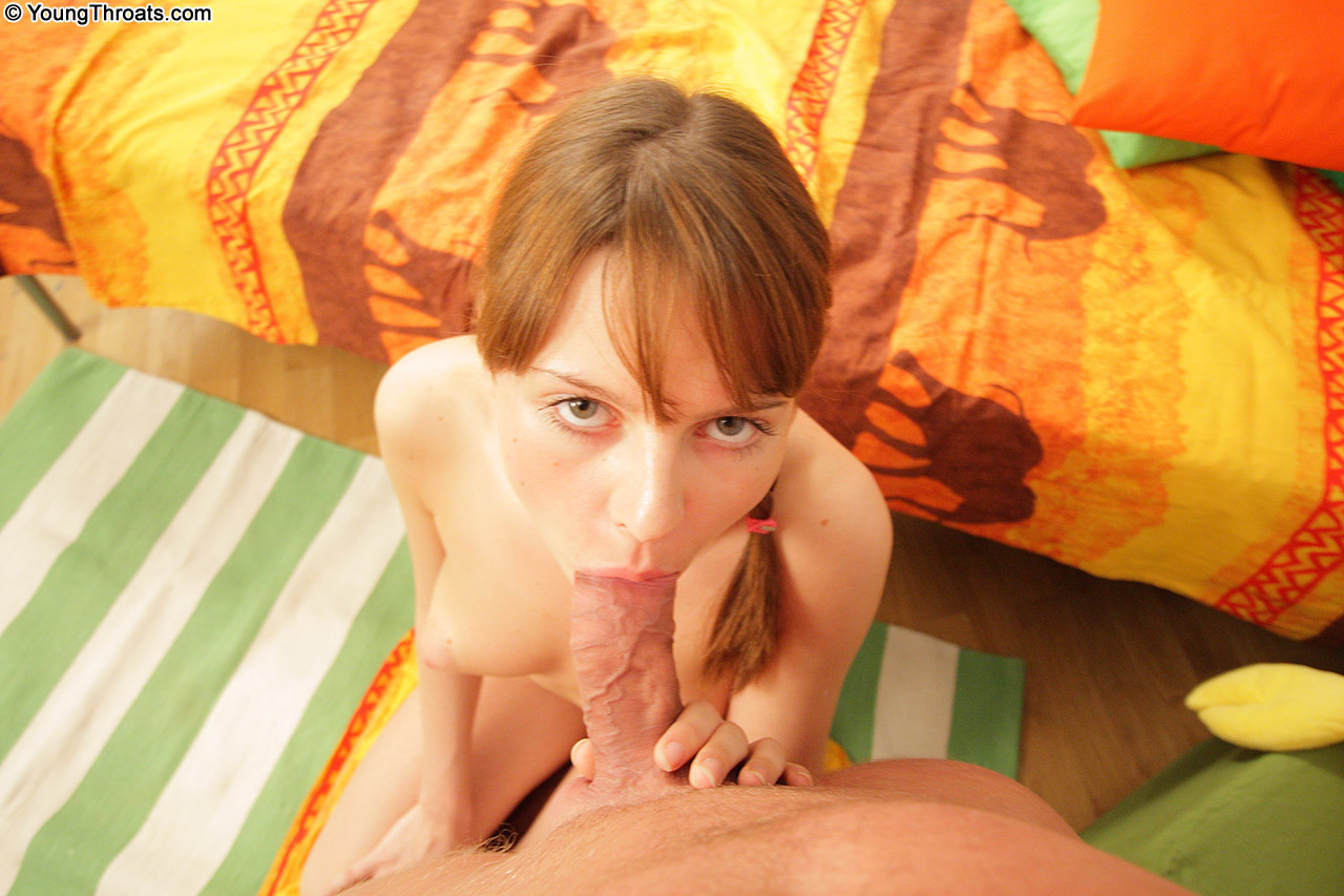 Adorable priestess of love with excited lips doing a sunny blowwork